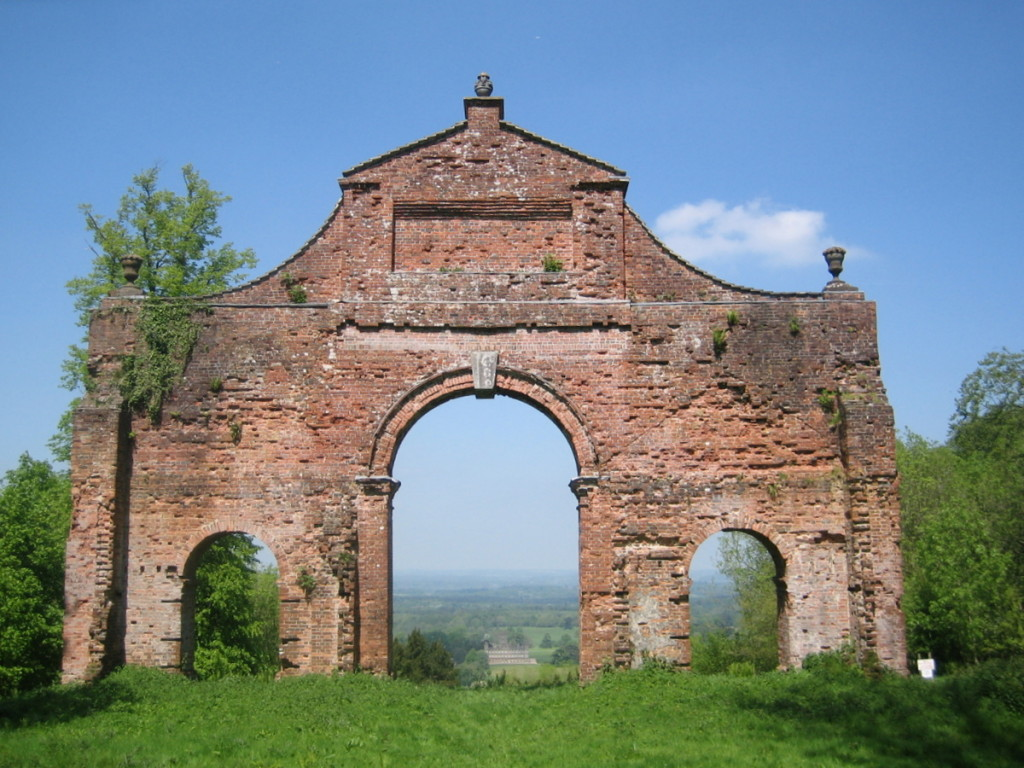 Heaven's Gate folly with Highclere Castle visible through the arch and a feral colony in residence to the top left of the arch.